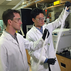 Ryan Lively in the lab with student