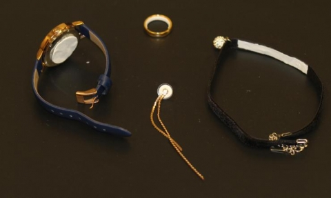 <p>Image shows potential contraceptive jewelry, in clockwise order, a pharmaceutical watch, ring, choker necklace and earring. In each case, a white contraceptive patch material is applied to a part of the jewelry that would be in contact with the skin. (Credit: Mark Prausnitz, Georgia Tech)</p>