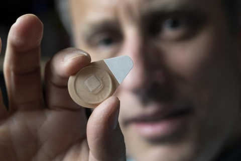 <p>Regents Professor Mark Prausnitz holds an experimental microneedle contraceptive skin patch. Designed to be self-administered by women for long-acting contraception, the patch could provide a new family planning option. (Credit: Christopher Moore, Georgia Tech)</p>