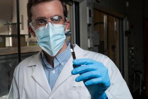 <p>Georgia Tech Associate Professor Ryan Lively holding a small sample used to experimentally understand how the xylenes transport through the carbon structure. (Photo credit: Christopher Moore, Georgia Tech)</p>