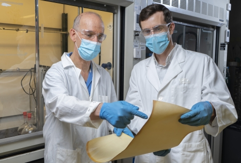 Associate Professor Ryan Lively from Georgia Tech's School of Chemical and Biomolecular Engineering and Professor M.G. Finn from the School of Chemistry and Biochemistry examine membrane material produced at Imperial College based on a new polymer material. (Credit: Christopher Moore, Georgia Tech)