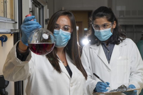 eorgia Tech graduate research assistants Kirstie Thompson and Ronita Mathias with a flask containing polymer materials used to create a new membrane technology that could reduce carbon emissions and energy intensity associated with refining crude oil. (Credit: Christopher Moore, Georgia Tech)