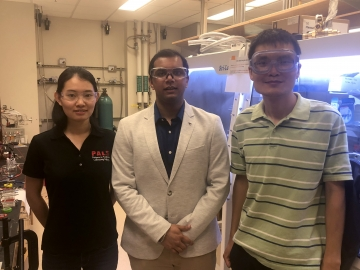Grad student Yamin Zhang, undergrad Anmol Mather, and Assistant Professor Nian Liu research battery technologies in the lab.